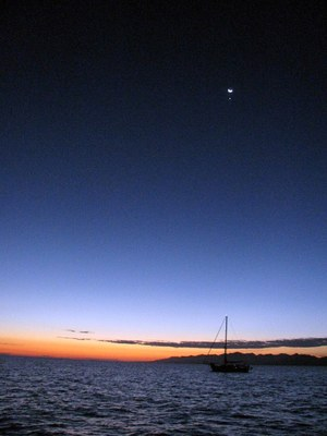 Moon and Venus close to conjunction with Konami sailing