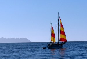 Sailboat Yare with colourful sails