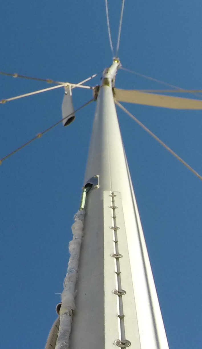 Looking up from our foredeck, showing a dangling spreader and bent mast