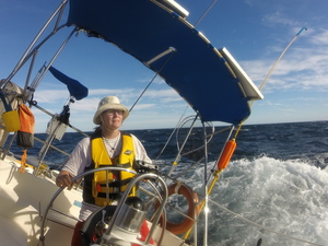 Barb at helm in boisterous sail to Isla Esteban