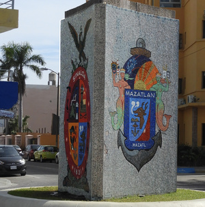 Mazatlan and Sinaloa crests on pillar in street