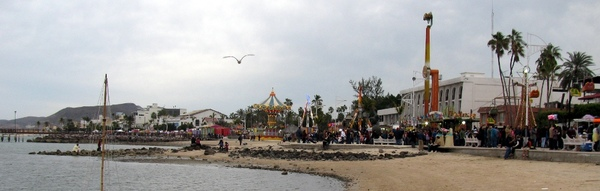 View of Parade and Midway rides from the beach